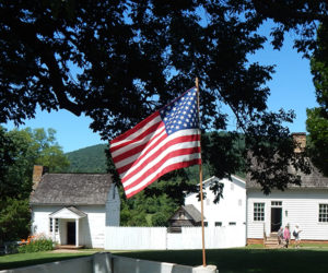 American Flag and Highland outbuildings