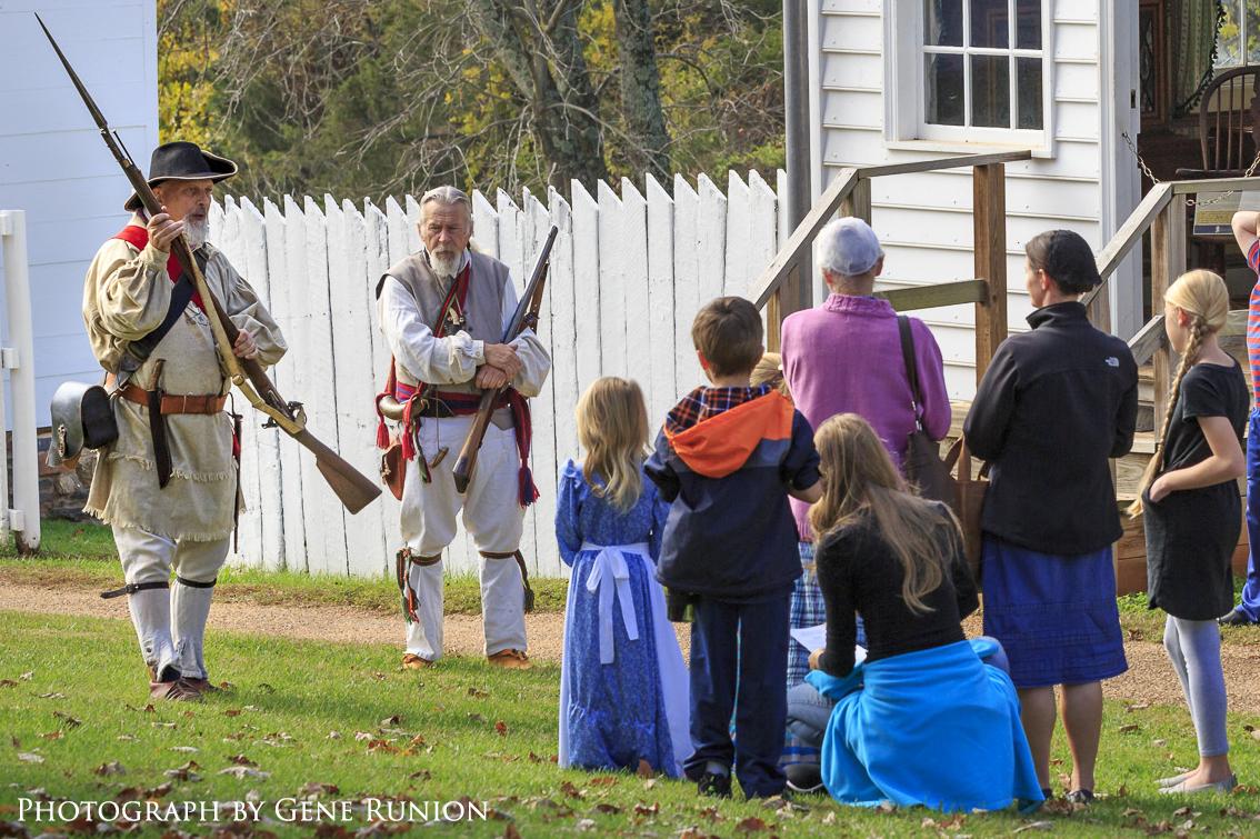 children listening to war of 1812 reenactors