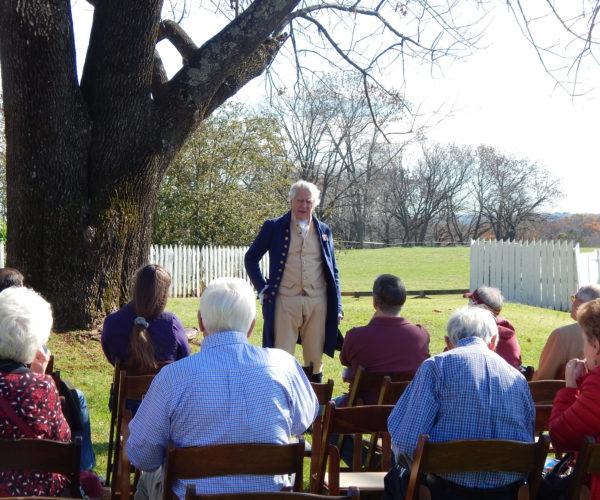 Actor dressed as Monroe speaks to crowd