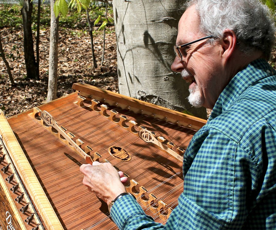 musician playing hammered dulcimer