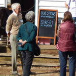 Guests learning about enslaved workers